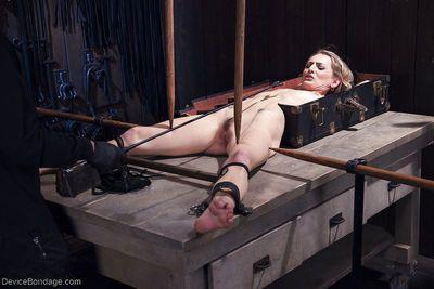 Euro blonde Natasha Starr is bound in dungeon for kinky BDSM sex games