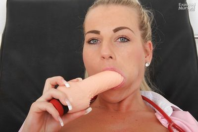 Sexy nurse stuffs her cunt with a speculum and exposes it in close up