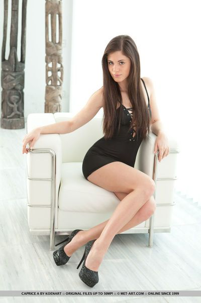 European beauty Caprice A strips off short dress to reveal trimmed vagina
