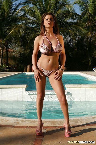 Big titted pornstar Roberta Misoni flaunting nude on the beach