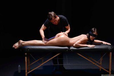 Blindfolded pornstar Peta Jensen is massaged by two men before DP