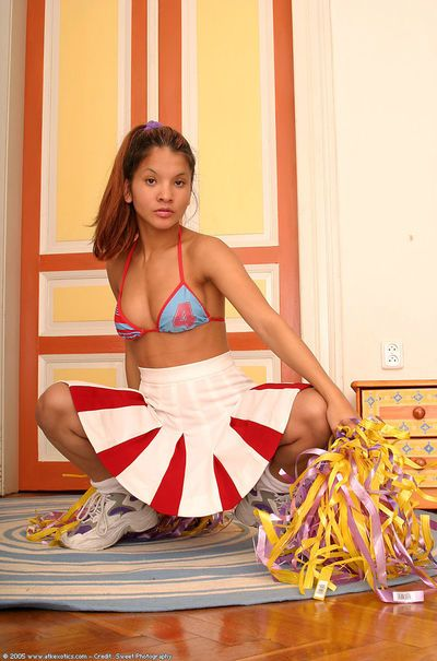 Amateur Asian babe loosing small tits from cheerleader uniform