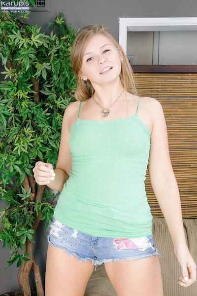 Young amateur angel Melissa May strokes herself and spreads her crotch