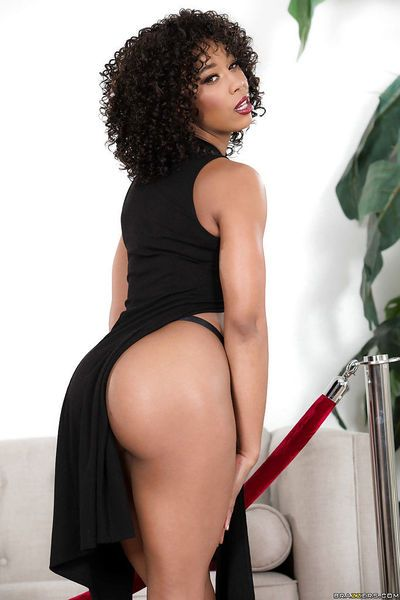 Top rated black pornstar Misty Stone undressing to model naked in high heels