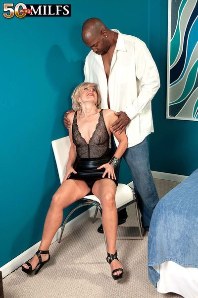 Blonde mature angel Ellie Anderson goes interracial hardcore with a black dude