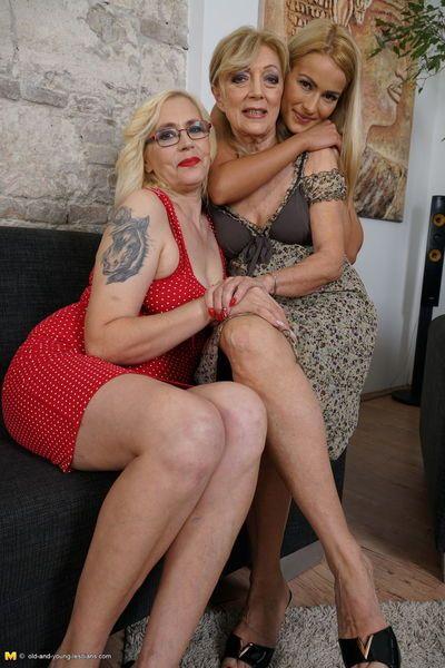 Mature blonde women coerce a young blonde into a lesbian threesome