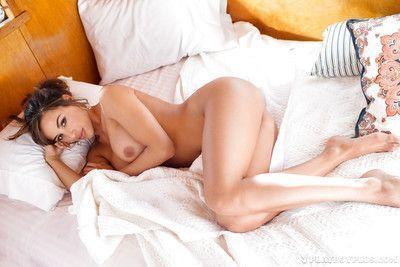 Long legged brunette centerfold model Ana Cheri exposes big breasts in kitchen