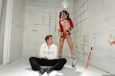 Cosplay attired Riley Reid giving restrained doctor ball licking blowob