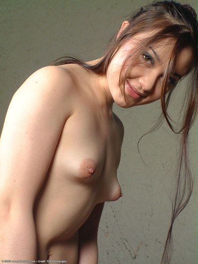Gorgeous Asian amateur Angelica undressing outdoors in back yard hammock