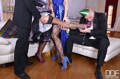 Leggy stocking clad party girls give footjob for cumshot after anal sex