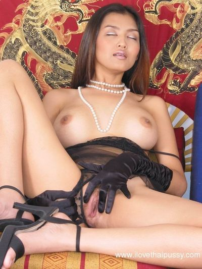 Busty asian babe in erotic lingerie masturbating her hairy cooter
