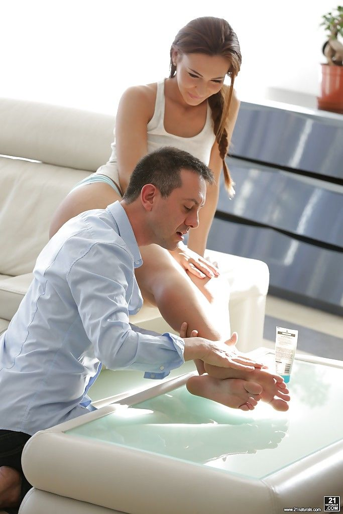 European pornstar displaying great legs while taking cumshot on feet