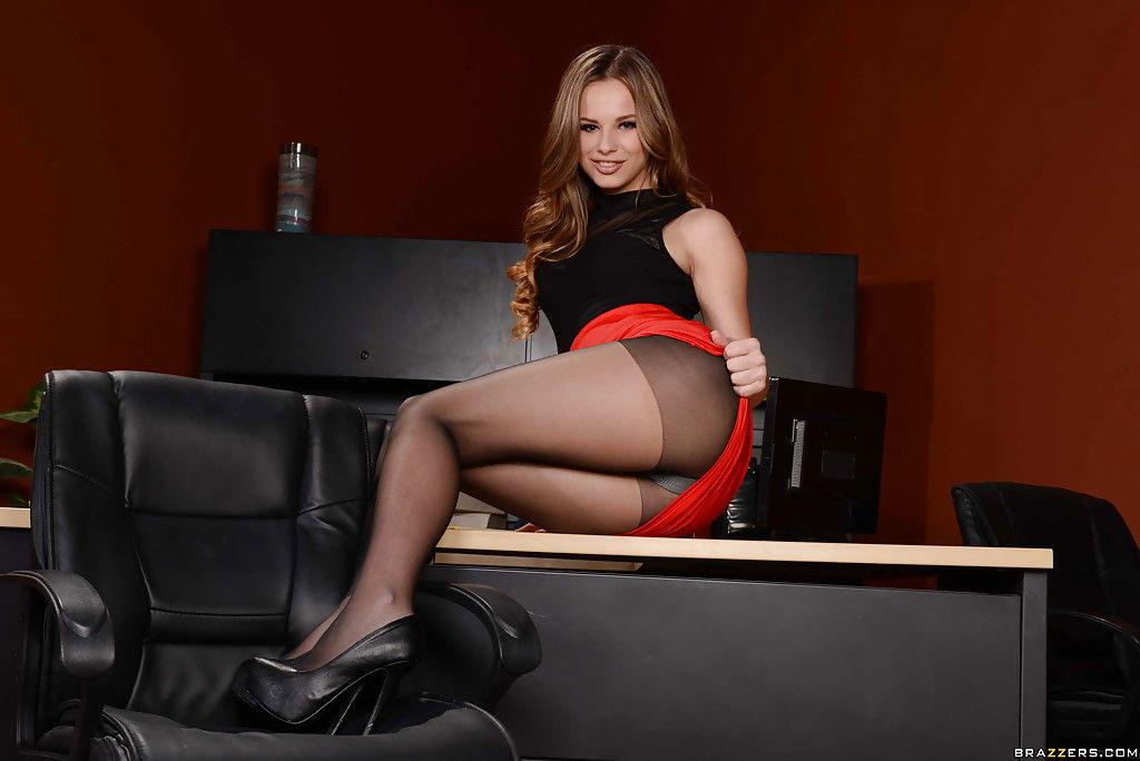 Teen office worker Jillian Janson shows off her nylon housed legs