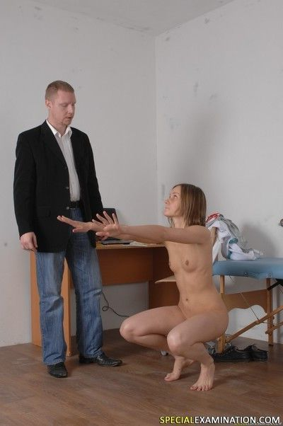 Squatting and jumping nude medical examinee