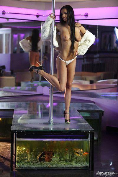 Graceful brunette babe with long legs on high heels dancing striptease