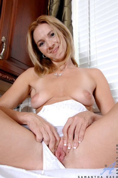 Samantha rae exposes her natural breasts while spraying her milf
