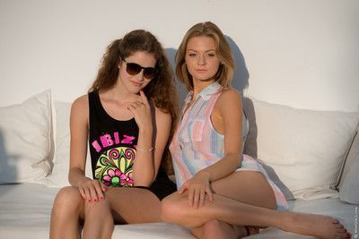 Seductive totally naked teens make out by the pool