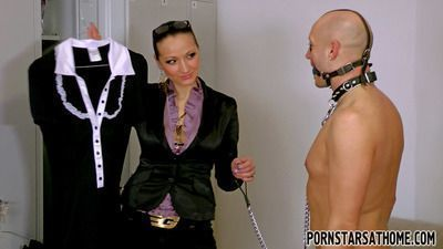 Fetish pornstar Gina Killmer torturing her slave dressed like a maid