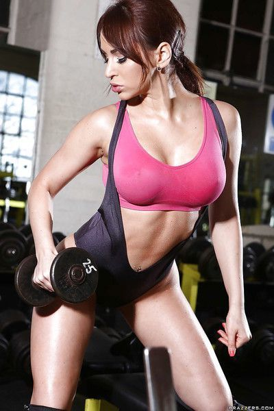 Sporty babe in sexy outfit revealing her big shapely tits in the gym