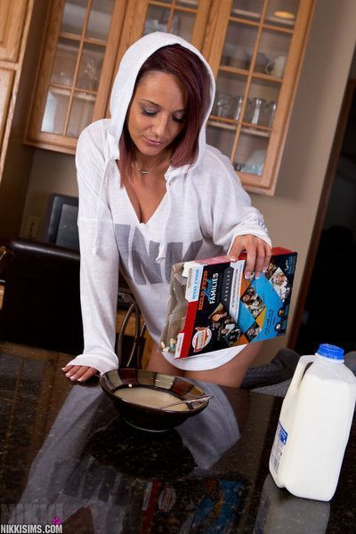 Hot babe Nikki Sims teases with her big jugs while having breakfast