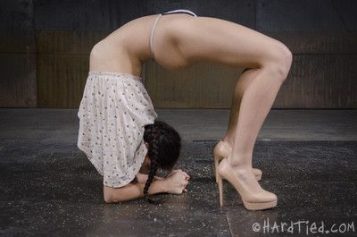 He has her in an asymmetrical bind, her limbs pulled to the side and her pussy e