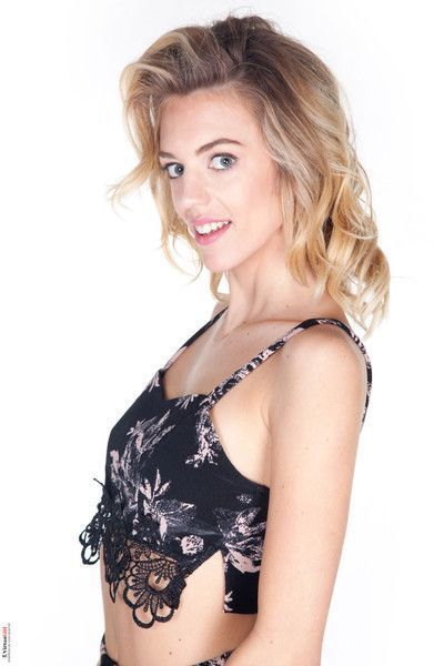 Slim blonde strips out of her lace floral top and skirt