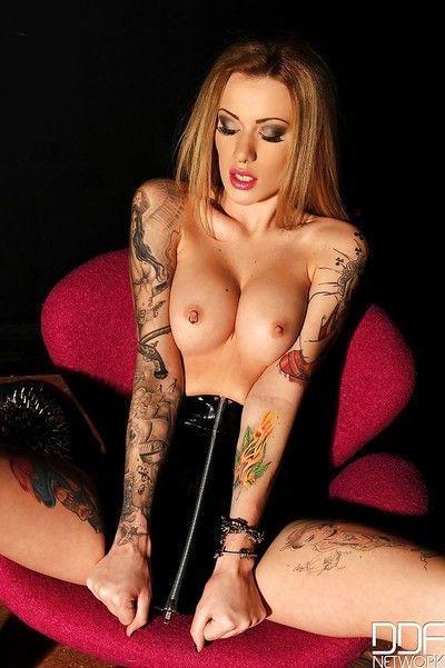 Leggy blonde chick Becky Holt having a cigarette while undressing