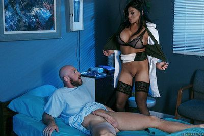 Busty doctor Audrey Bitoni stripping down to lingerie to suck cock