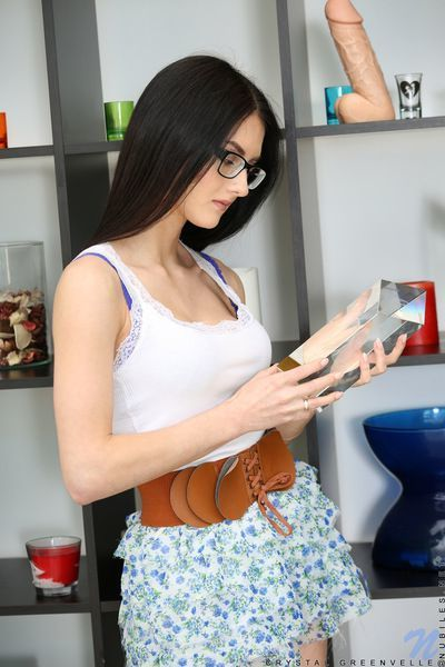 Pretty female coed Crystal Greenvelle in glasses stripping to lace lingerie