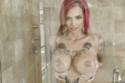 Hot redhead Anna Bell Peaks showing off tattoos and big tits in shower