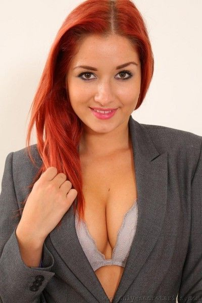 Redhead secretary with awesome tits