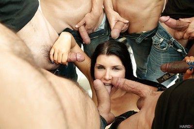 American pornstar Romi Rain getting covered in facial jizz during blowbang