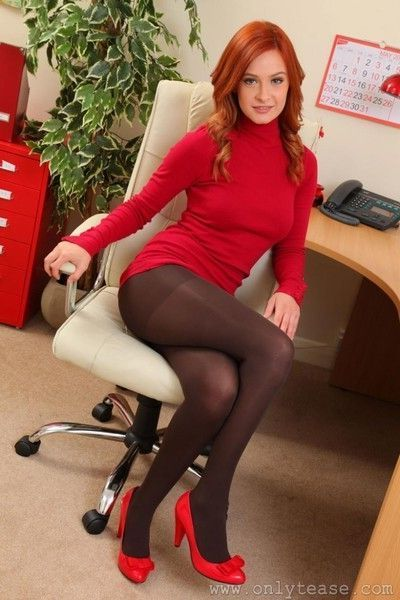 Sweet redhead strips in her office