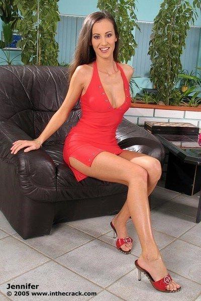 Stunning slim babe in a red dress Jennifer rides on a big dildo