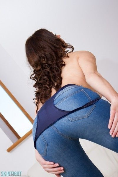 Busty brunette beauty in her tight jeans and blue top
