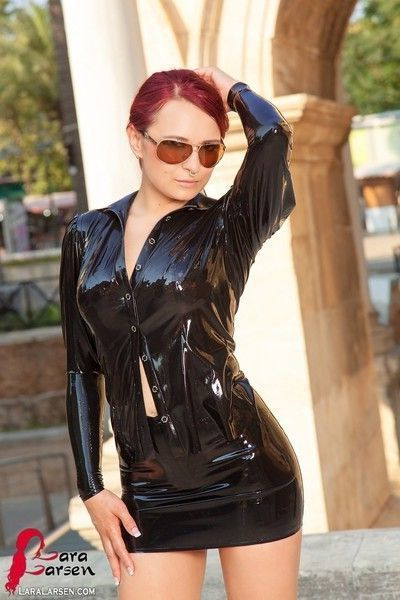 Redhead in tight latex