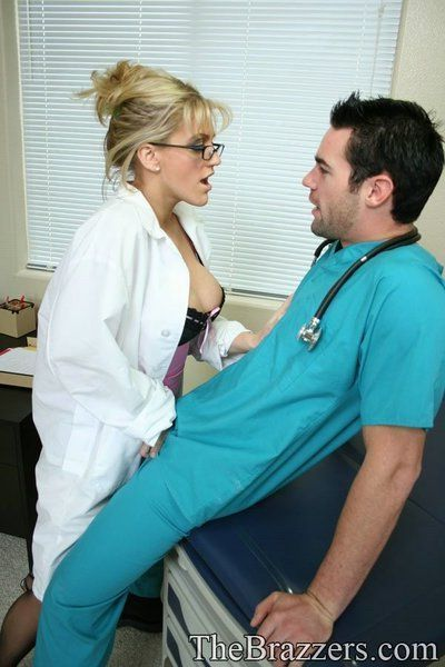 Busty doctor Eve Laurence strips to her stockings to have wild sex