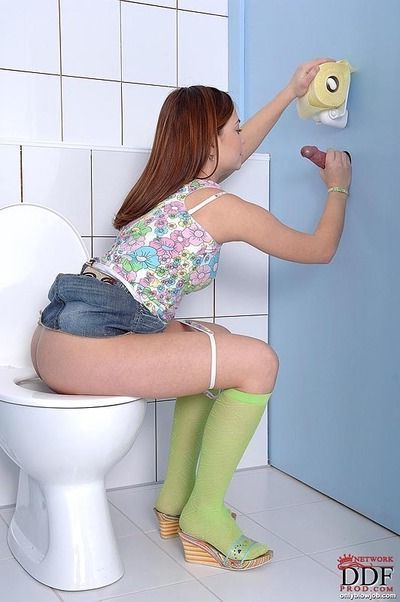 Petite teen babe in green socks Lola sucking a huge cock in the toilet