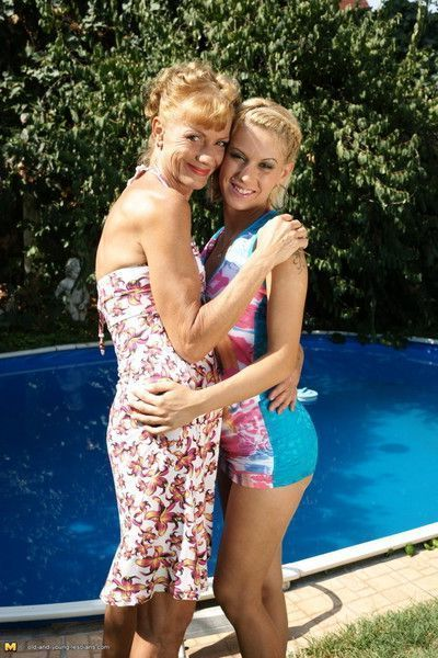 Two old and teen lesbians making out at the pool