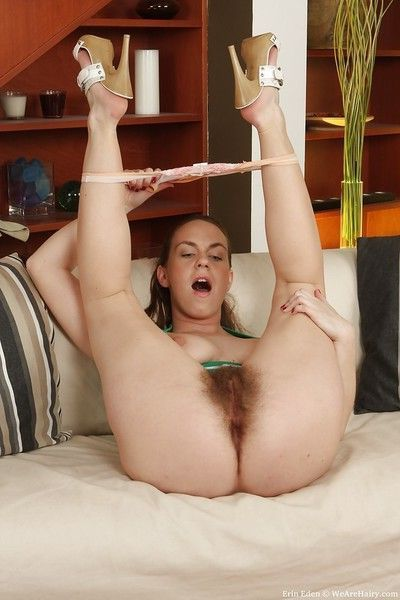 Fuckable babe with big tits Erin Eden toying her hairy cunt