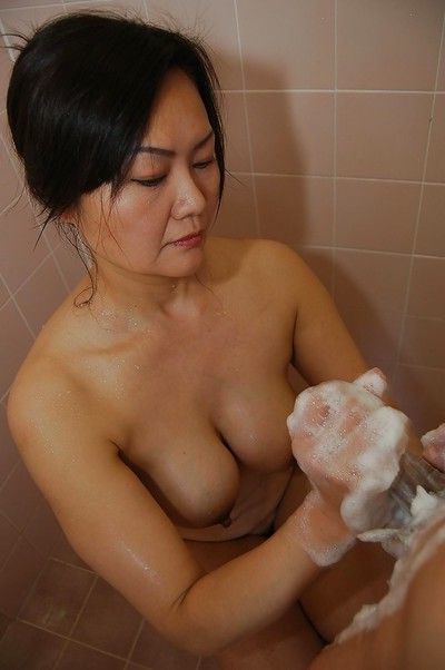 Asian MILF Kaoru Mitamura pleasing a swollen cock with her mouth and tits