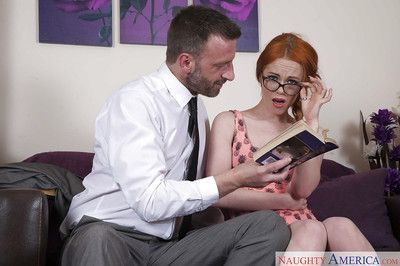 Glasses topped redhead coed Ella Hughes taking facial cumshot