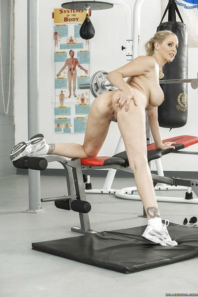 Sporty MILF with gorgeous big tits Julia Ann stripping in the gym