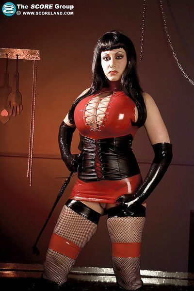 Hot busty vixen in latex dress Crystal Gunns gets off with fetish toys