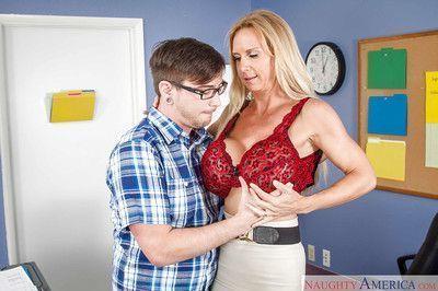 Cougar blonde Brooke Tyler gets a big load of sperm on her boobs