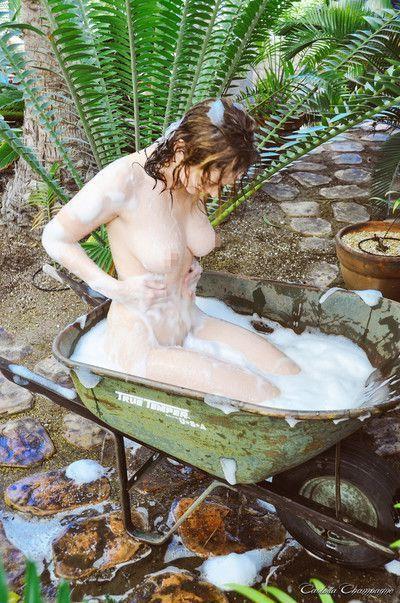 Stunning brunette carlotta getting wet outside