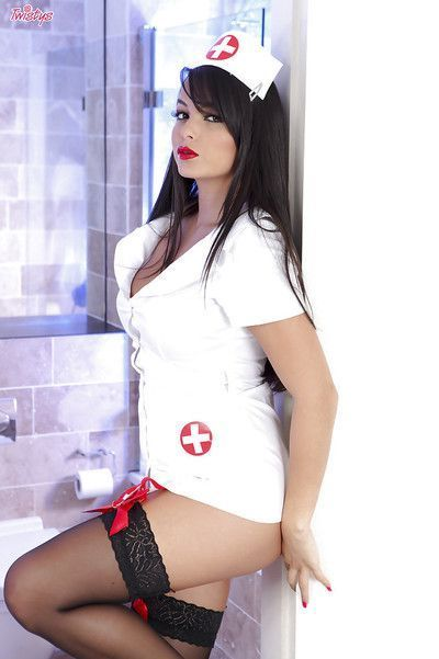 Steamy nurse in nylons taking off her uniform and spreading her pussy