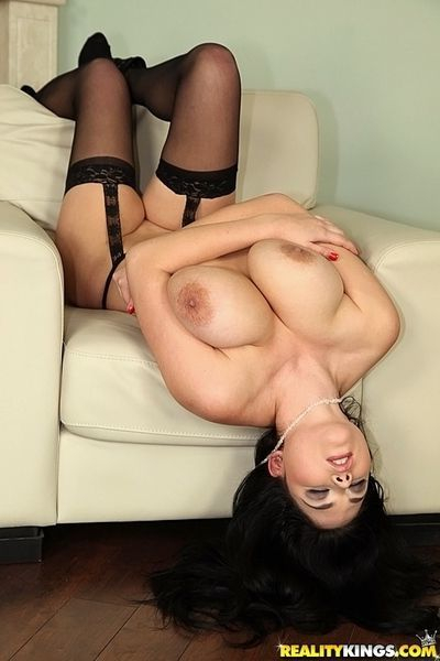 Busty babe Shione Cooper slipping off her lingerie and licking her nipples