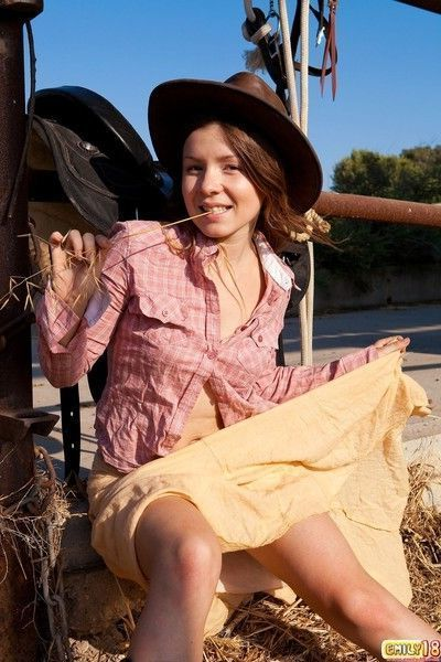 Petite cow girl revealing her tiny tits and sweet pussy