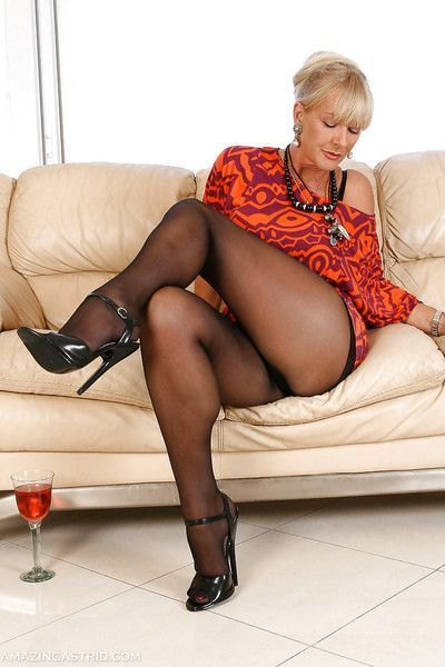 Blonde pantyhose model Amazing Astrid letting large tits free